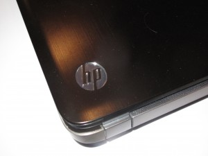 HP Pavillion dv7-6013TX laptop computer - reflective HP logo on lid