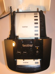 Brother QL-700 label printer with tape loaded