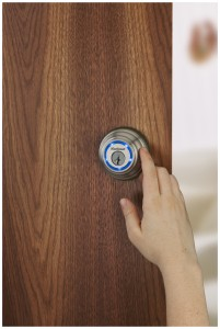 Kwikset Kevo cylindrical deadbolt in use - Kwikset press image