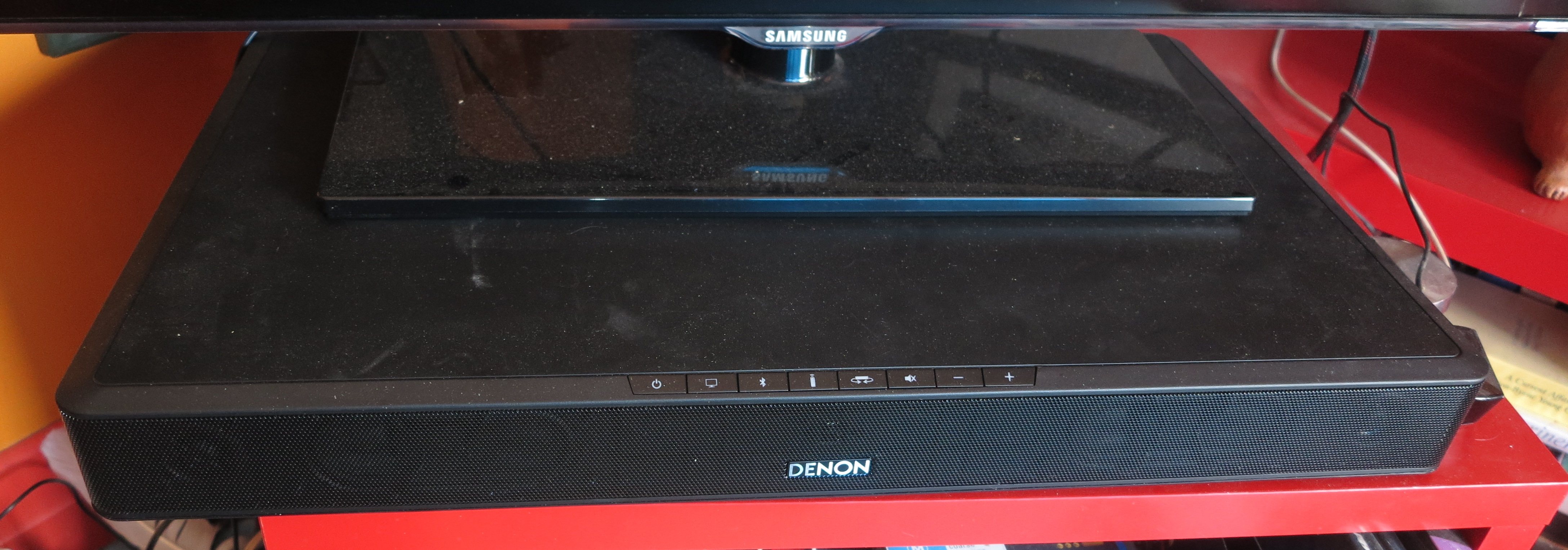 Denon DHT-T100 TV pedestal speaker in use