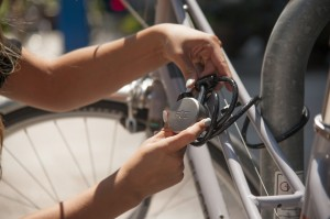 Locking up a bike wiht the Noke padlock - Press photo courtesy Fuz Designs