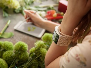 Samsung Gear S smartwatch (her with smartphone) press picture courtesy of Samsung