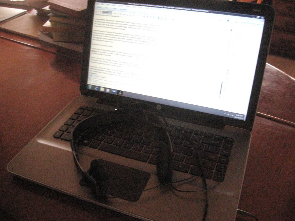 HP Envy alongside B&O headphones