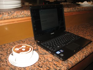 Toshiba Portege R830 ultraportable on coffee bar at a cafe