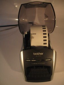 Brother QL-570 thermal label printer tape compartment with tape