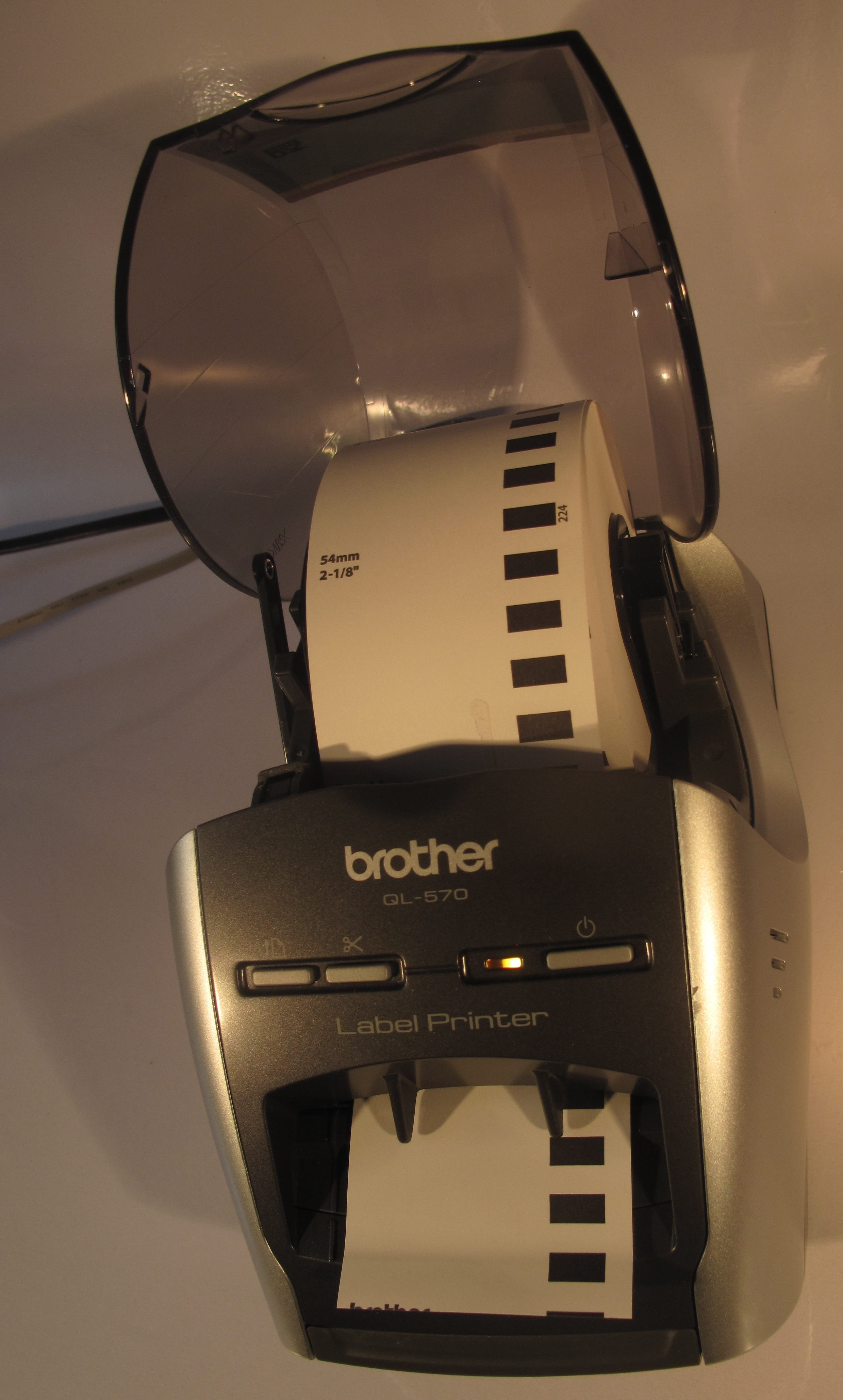 Brother QL-570 thermal label printer tape path shown