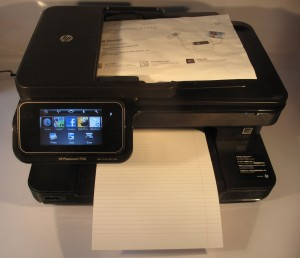 HP Photosmart 7510 multifunction inkjet printer with paper in scanner and output