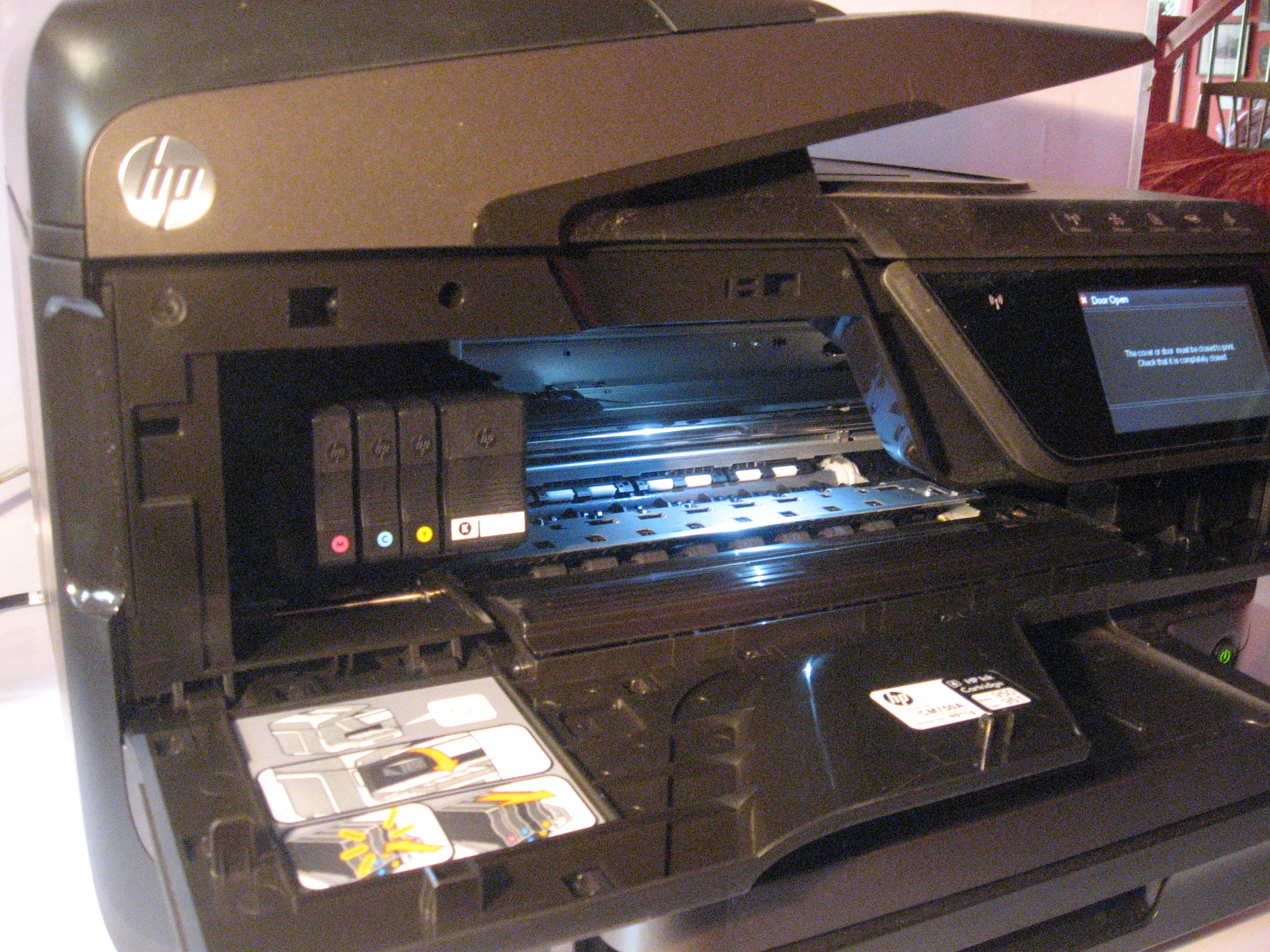 HP OfficeJet Pro 8600a Plus all-in-one printer illuminated mechanism bay