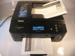 Brother DCP-J925DW multi-function printer with paper loaded