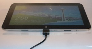 HP Envy X2 main tablet unit connected to the charger