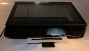 Envy 120 designer all-in-one printer printing a document
