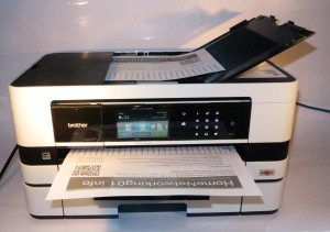 Brother MFC-J410DW sideways-print multifunction inkjet printer - loaded deck view with lengthways document output
