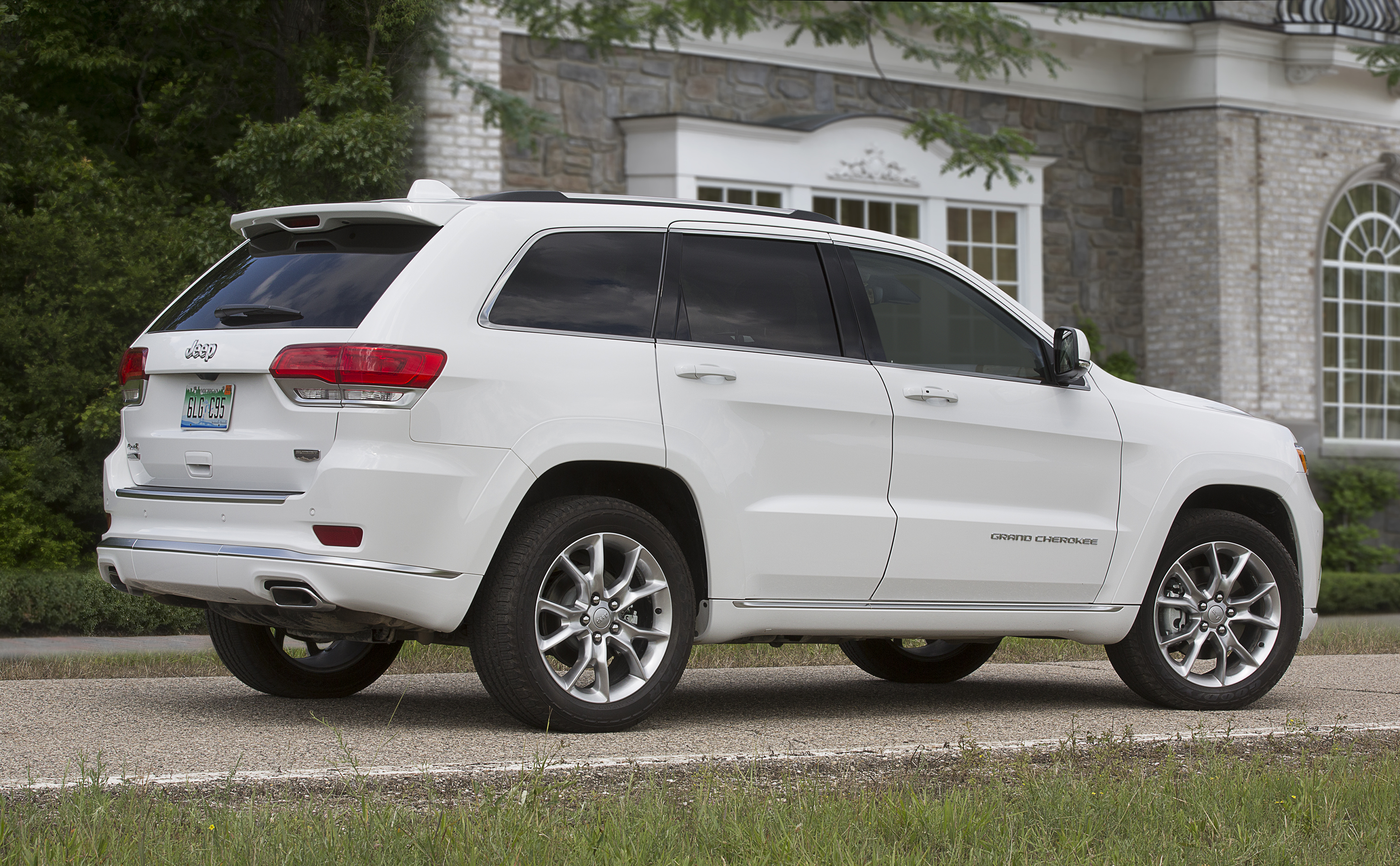 Jeep Grand Cherokee outside family house - press picture courtesy of Fiat Chrysler North America
