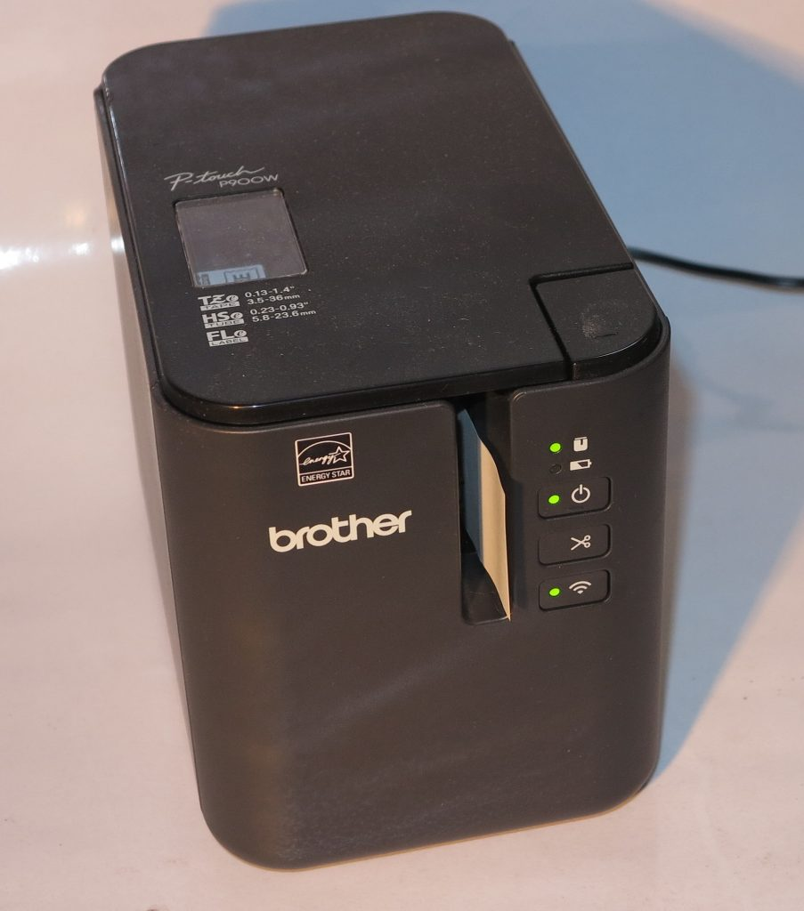 Brother PT-P900W label printer turning out a label
