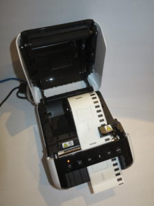 Brother QL-1110NWB network label printer loaded with standard label tape
