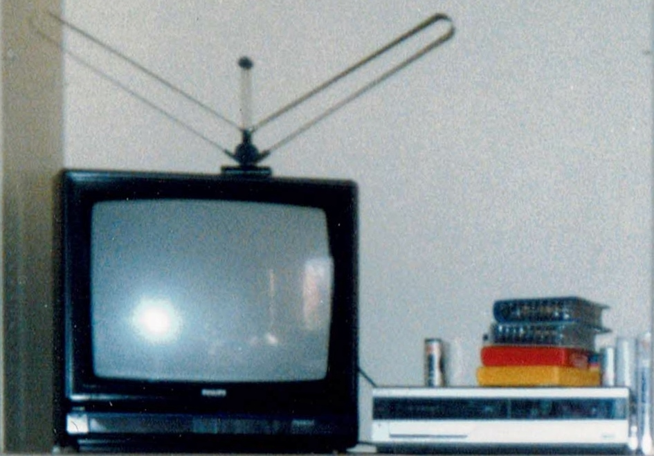 TV, VHS videocassette recorder and rented video movies