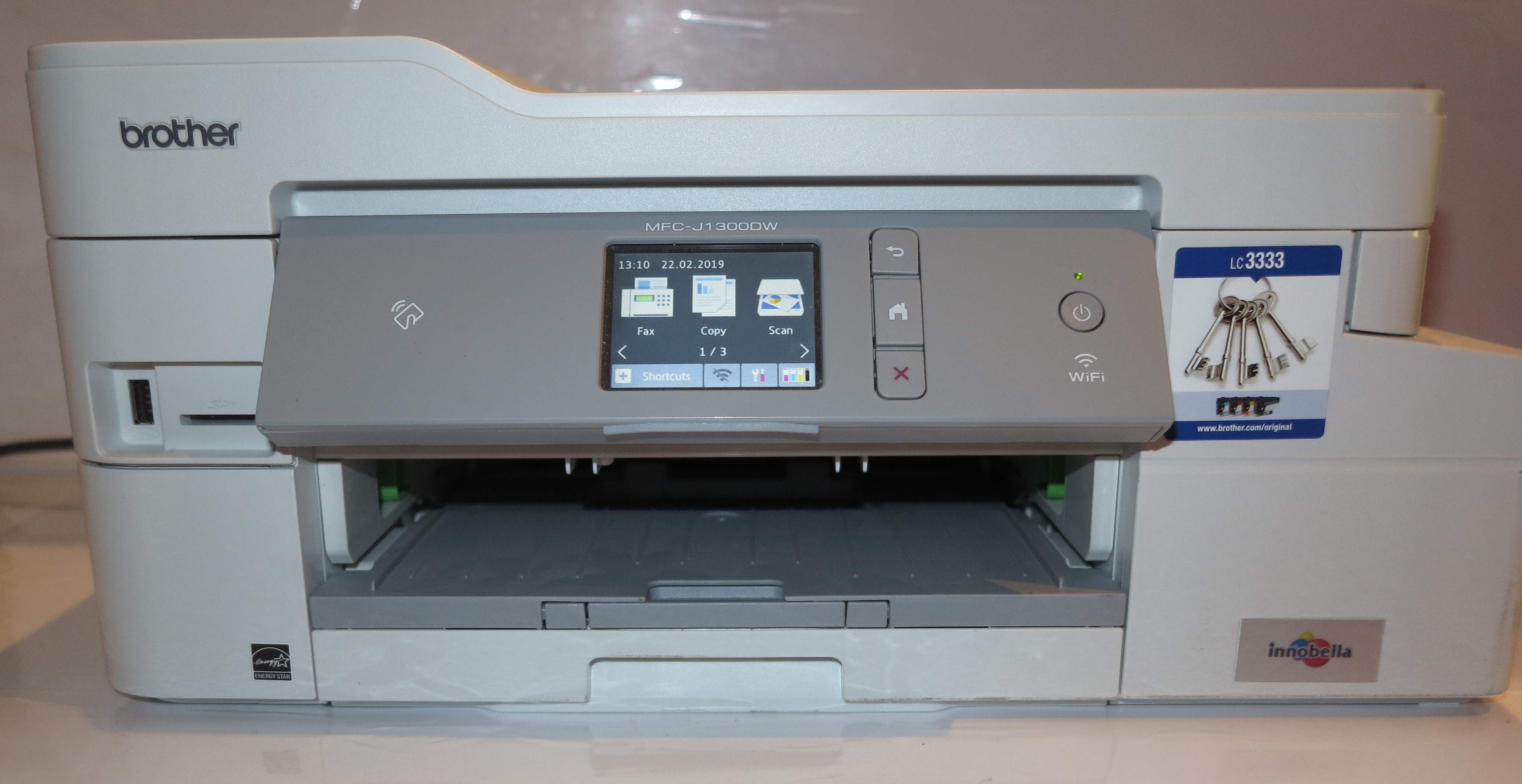 Why do I consider a digital fax vault an important feature for multifunction printers?